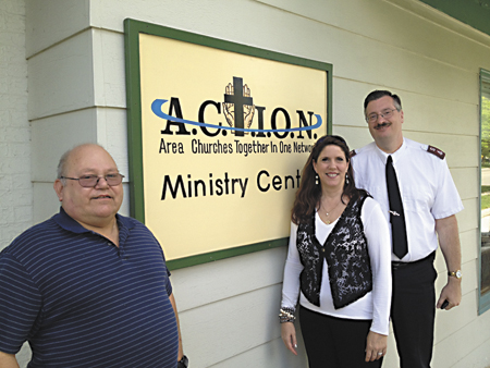 Volunteer Carl Bogen from Federated Covenant Church with Jan Nowak, director of caring ministries/social services, Maj. Bill Walters, commander of Niles Salvation Army, which serves all of Cass and southern Berrien counties, outside ACTION, 301 Main St.