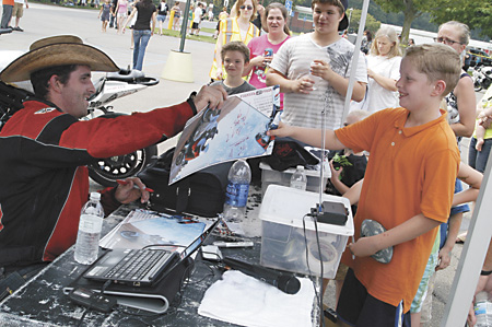 """Josh """"The Cowboy"""" Borne, No. 9 professional street bike freestyler in the world, signs autographs Saturday at the Ride for the Homeless at Southwestern Michigan College."""